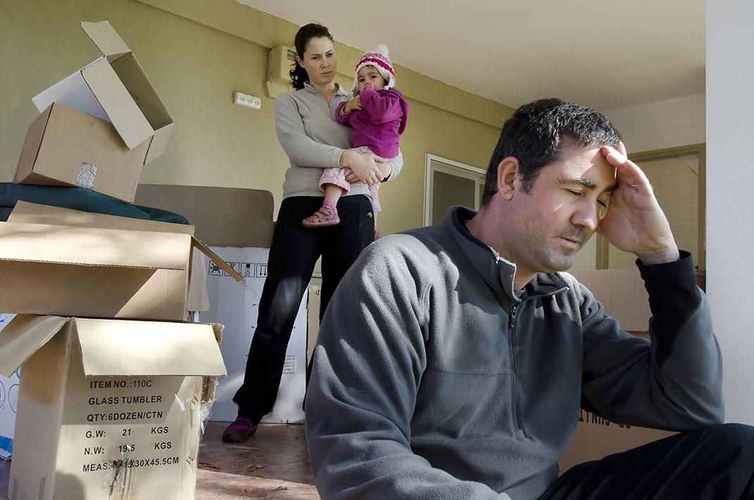 Une famille en désespoir via Shutterstock